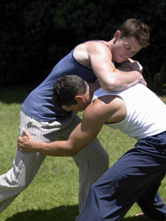young men: Two young men wrestling LANG_EVOIMAGES