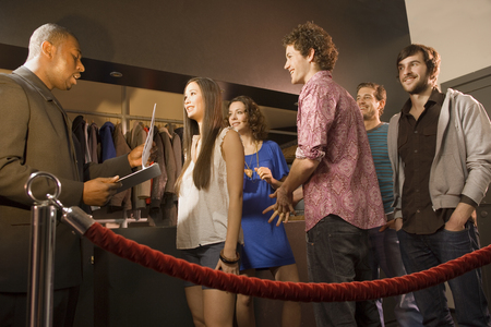 roped off: Friends entering a club
