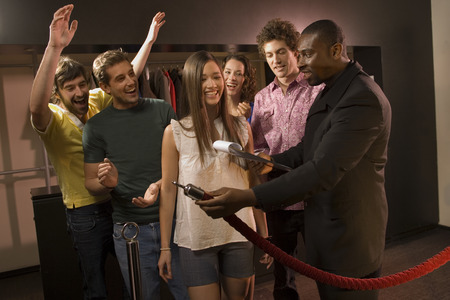 Friends entering a club