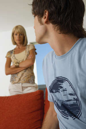 low blouse: Boy upset,mother in the background