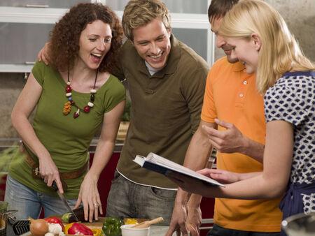 четыре человека: Four people preparing food in the kitchen
