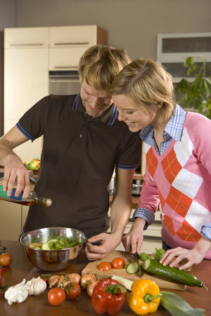 checkered polo shirt: Couple making salad LANG_EVOIMAGES