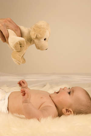two persons only: Baby playing with a soft toy