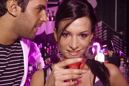 two persons only: Young couple at a bar LANG_EVOIMAGES