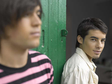 young men: Close-up of two young men