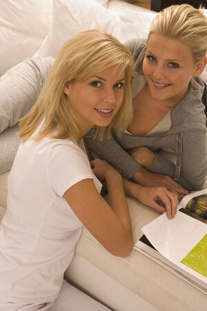 casual hooded top: Portrait of two young women smiling