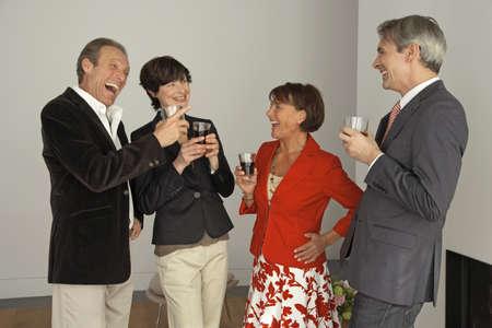 четыре человека: Four people holding wine glasses