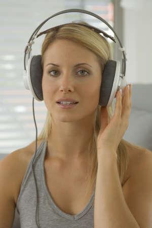 off shoulder: Woman wearing earphones
