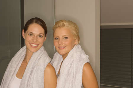 off the shoulder: Portrait of two women with towels