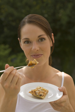 off the shoulder: Young woman eating