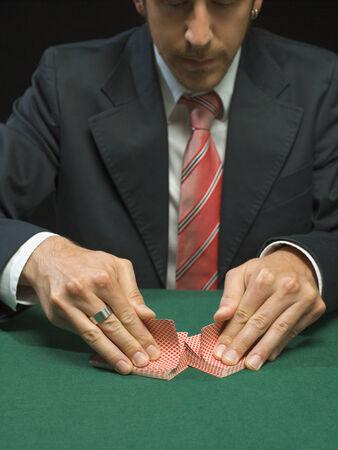 european ethnicity: Man shuffling playing cards