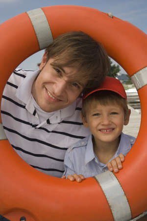 silliness: Father and son portrait with life saver