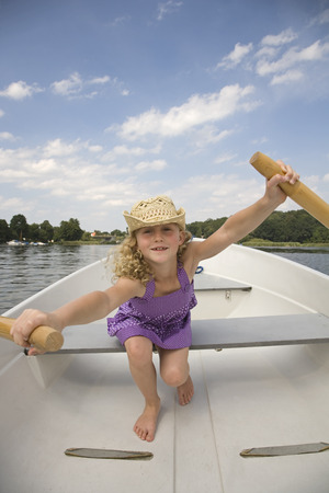 european ethnicity: Young girl rowing boat