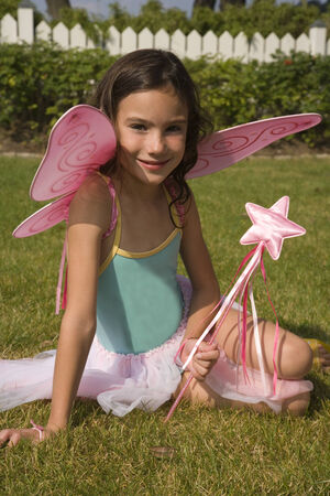 european ethnicity: Portrait of young girl with fairy wings and wand LANG_EVOIMAGES