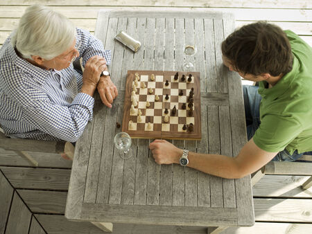 only two people: Father and son playing chess