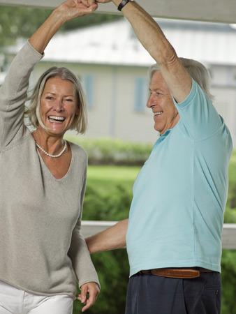 Senior couple dancing on veranda