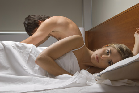 ignoring: Couple ignoring each other in bed