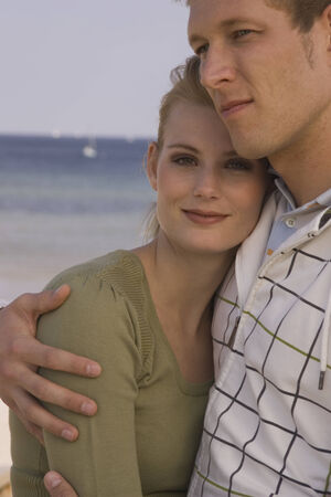 european ethnicity: Young couple hugging at the beach LANG_EVOIMAGES
