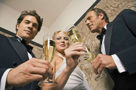 Portrait of three people holding champagne flutes  Stock Photo