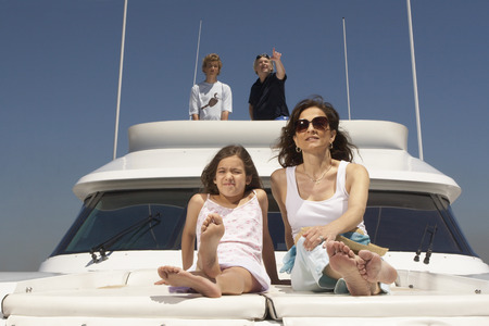 Young family relaxing on boat LANG_EVOIMAGES