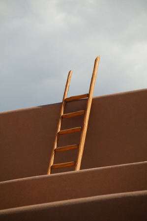 Ladder standing against an adobe house,New Mexico,USA LANG_EVOIMAGES