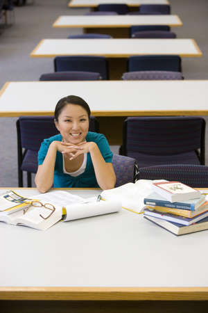 elevated view: Young woman studying in library, smiling, portrait, elevated view