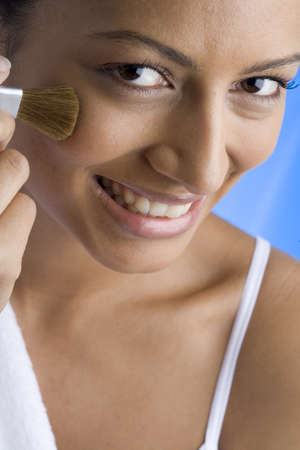 elevated view: Young woman applying make-up, smiling, portrait, elevated view