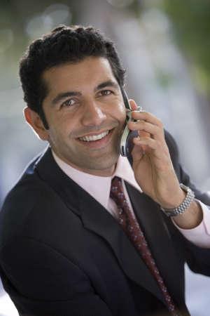 western european ethnicity: Businessman using mobile phone, smiling, close-up, portrait