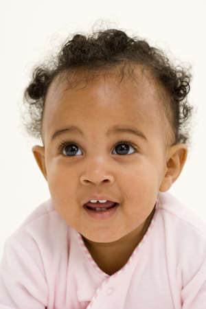 gratifying: Baby girl (3-6 months) smiling, close-up