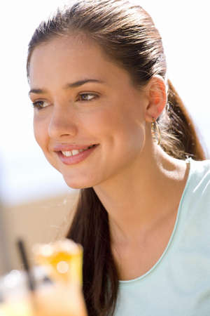 western european ethnicity: Young woman outdoors, smiling, close-up LANG_EVOIMAGES