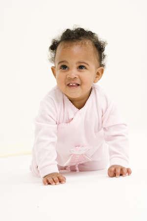 gratifying: Baby girl (3-6 months) smiling, portrait