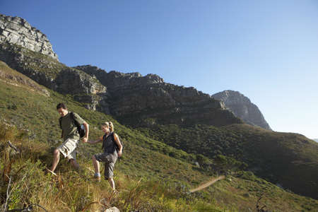 western slope: South Africa, couple hiking, ascending mountain, side view LANG_EVOIMAGES