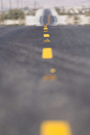 sunshines: Close-up of lines in middle of road in desert LANG_EVOIMAGES