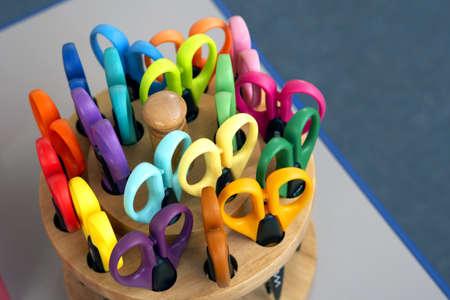 learnt: Multi-coloured scissors in pot, close-up (still life)