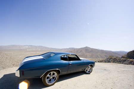 summery: Classic car in desert (lens flare)