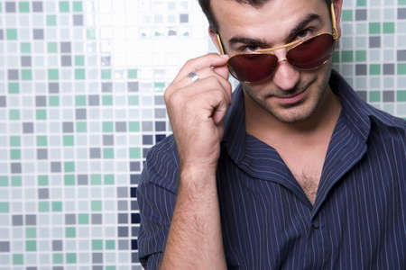 western european ethnicity: Young man wearing sunglasses, portrait, close-up