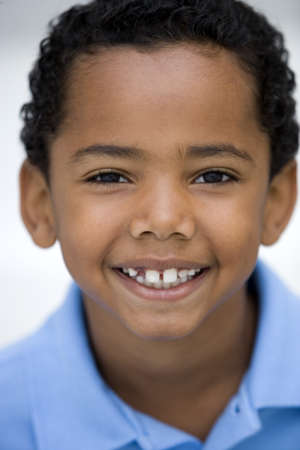 youthfulness: Boy (7-9) smiling, close-up, front view, portrait