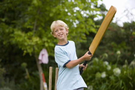 cricket bat: Boy (10-12) playing cricket, low angle view LANG_EVOIMAGES