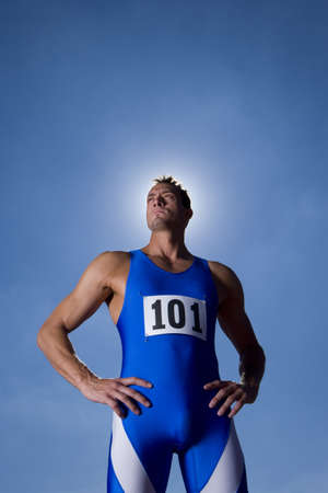 loo: Male athlete with hands on hips, low angle view