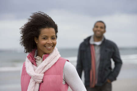 activ: Young couple on beach, portrait of woman smiling