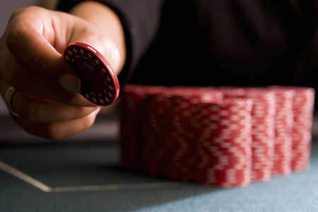 hope indoors luck: Woman placing gambling chip on table, close-up