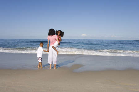enviro: Mother with son and daughter (4-8) on beach