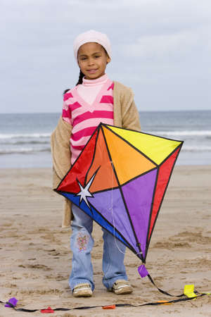 pers: Girl (5-7) with kite on beach, portrait