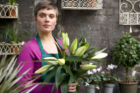 horizontals: Female florist with bunch of flowers, portrait
