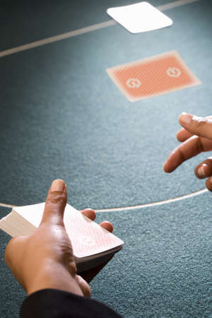 hope indoors luck: Croupier dealing cards, close-up of hands