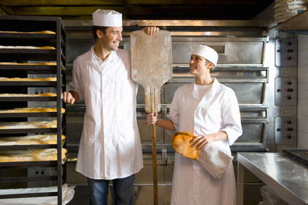 spat: Male and female bakers smiling at each other