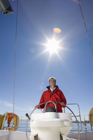 Man steering a boat