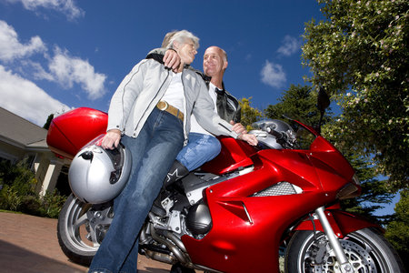 lavishly: Mature couple posing with motorcycle