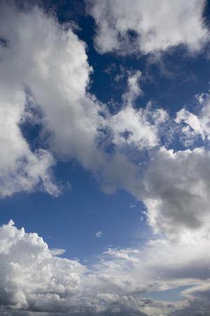 verticals: Clouds in blue sky