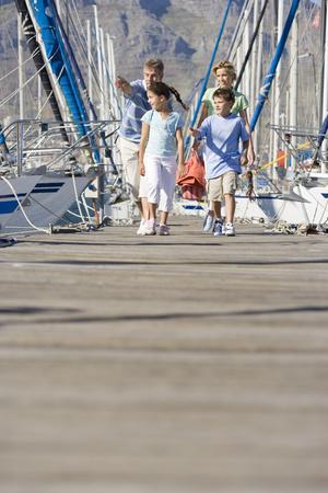 lavishly: Family walking in boat marina